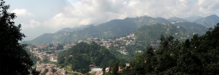 """Panoramic view of Mussoorie, Uttarakhand"" by Michael Scalet from India - Mussoorie"